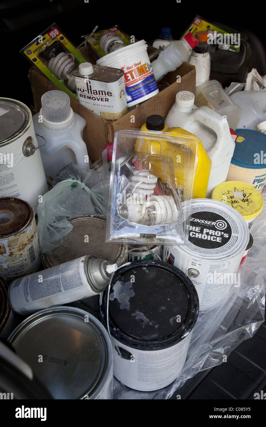 Containers of toxic and hazardous household chemicals being taken to designated recyclers - Stock Image