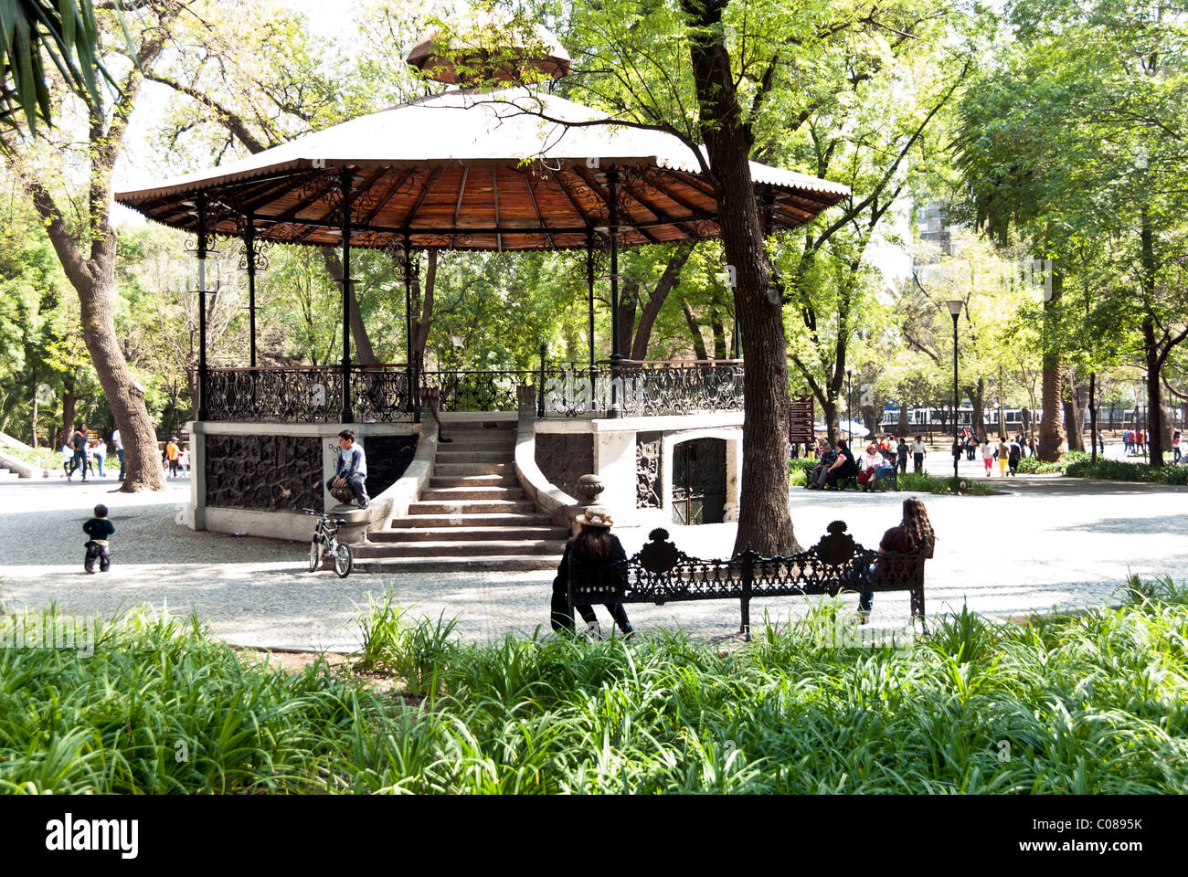 charming old 19th century bandstand amid greenery of Chapultepec Park with elaborate cast iron frame & wood - Stock Image
