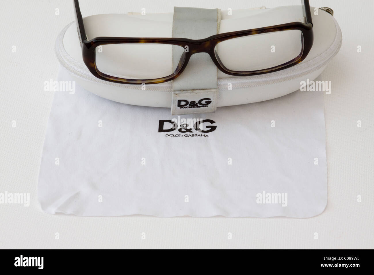 Dolce and Gabbana Prescription Glasses and cleaning cloth - Stock Image