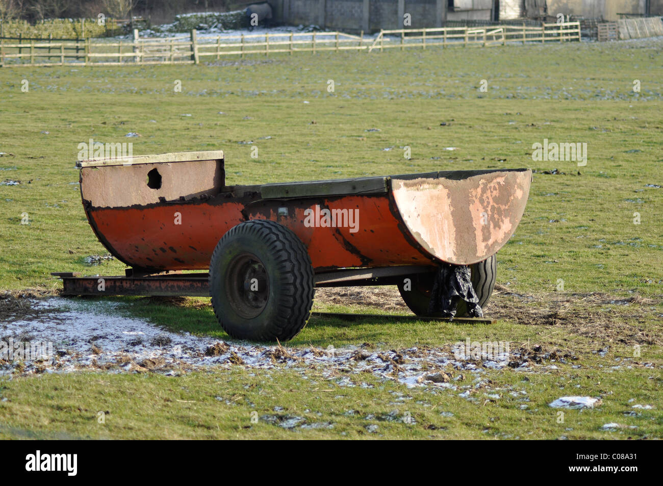 Farm tractor muck spreader trough, shot during winter on a British farm - Stock Image
