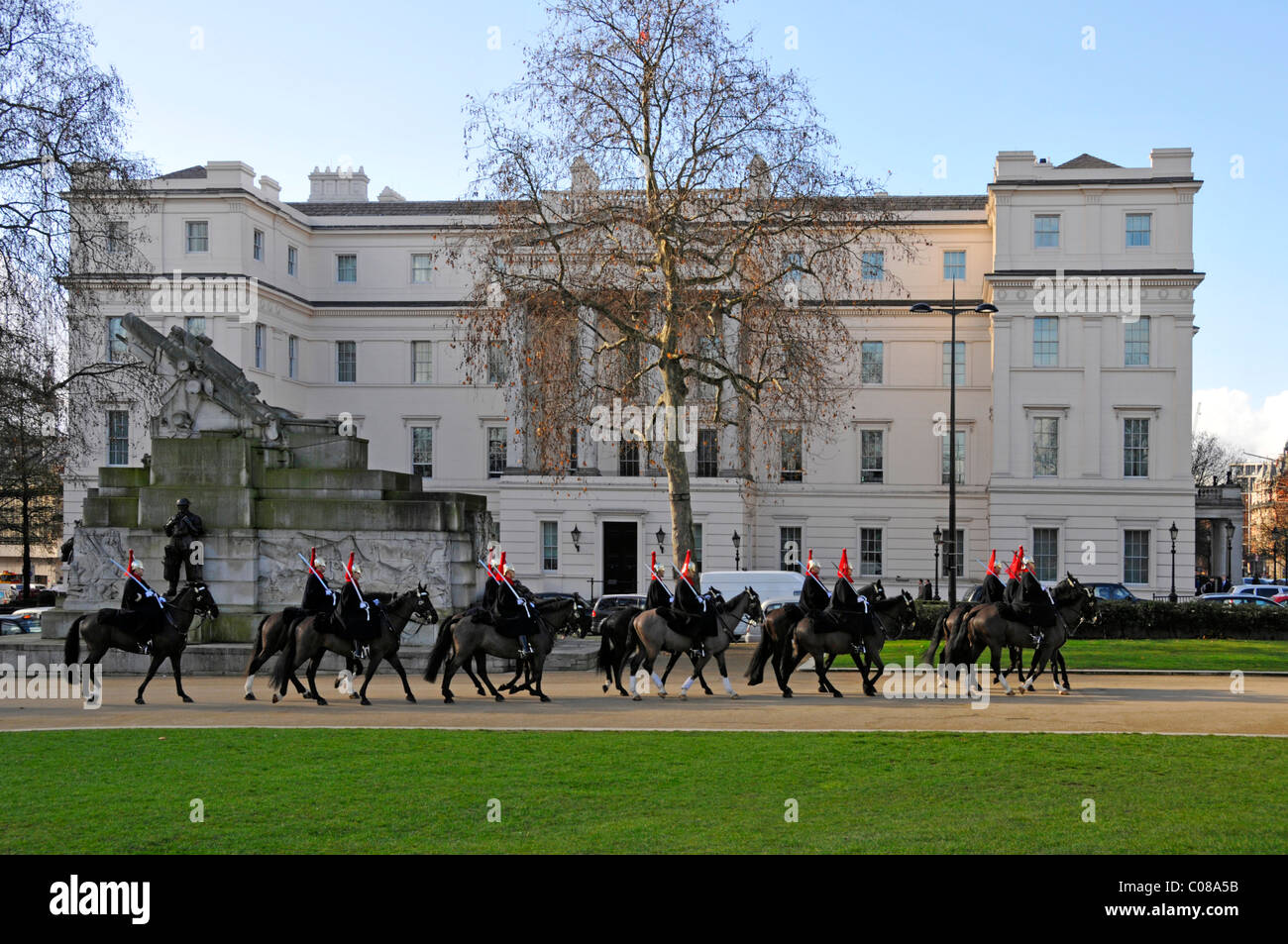 Household Cavalry horses & troopers passing Lanesborough Hotel 5 stars expensive luxury hotel on blue sky day - Stock Image