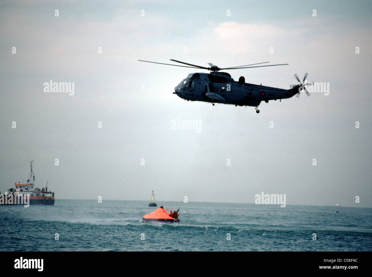 Helicopter coming to the rescue at sea - Stock Image