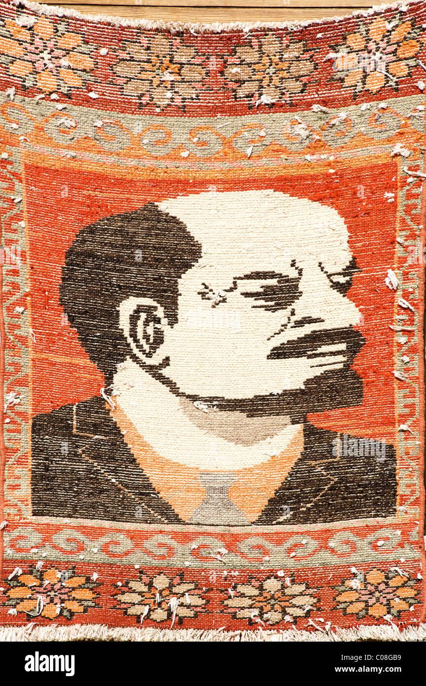 Handmade woven rug of Lenin, Bukhara, Uzbekistan - Stock Image