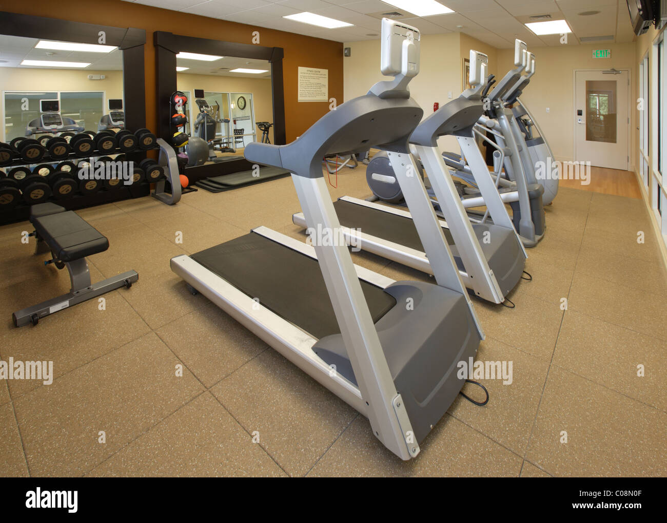 The fitness center in a hotel, with treadmills, free weights, stepper, and medicine balls. - Stock Image