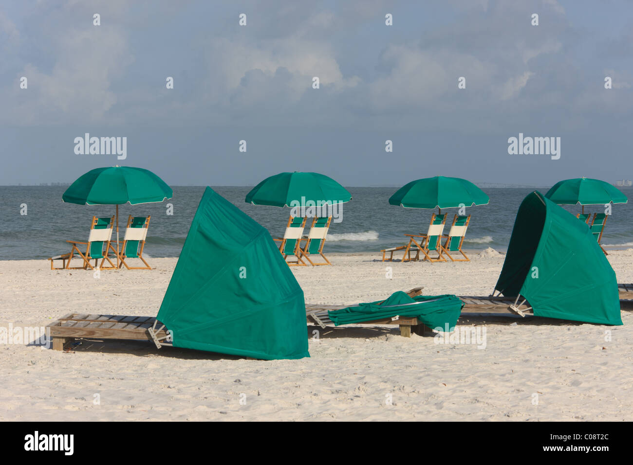 Vacant beach chairs and cabana loungers on a sunny day at a beach. - Stock Image