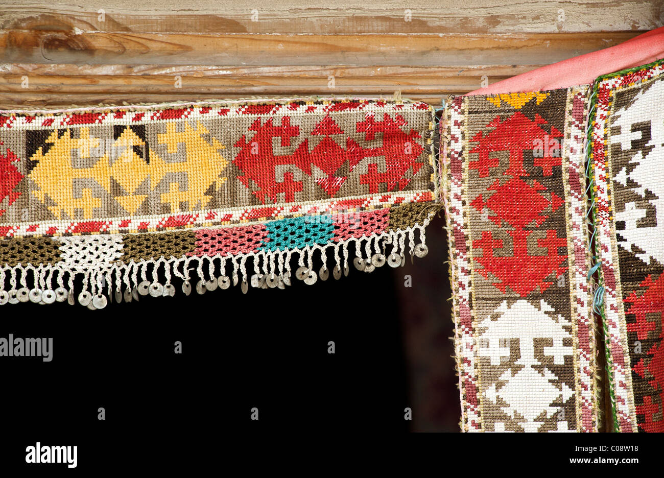 Colourful embroidered fabric hanging in a doorway Bukhara, Uzbekistan - Stock Image