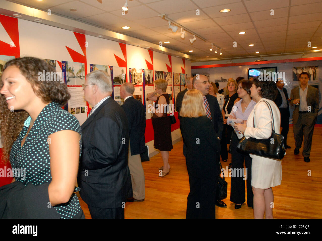 Guests view an exhibit honoring the Prime Minister Khalifa Bin Salman's success in urban development at the - Stock Image