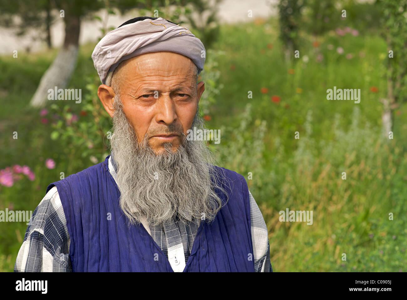 Muslim man wearing distinctive headcloth Bukhara, Uzbekistan - Stock Image