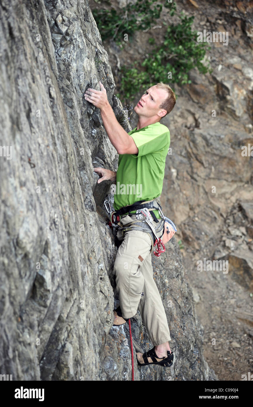 Man rock climbing along Turnagain Arm near Anchorage, Southcentral Alaska, Summer - Stock Image