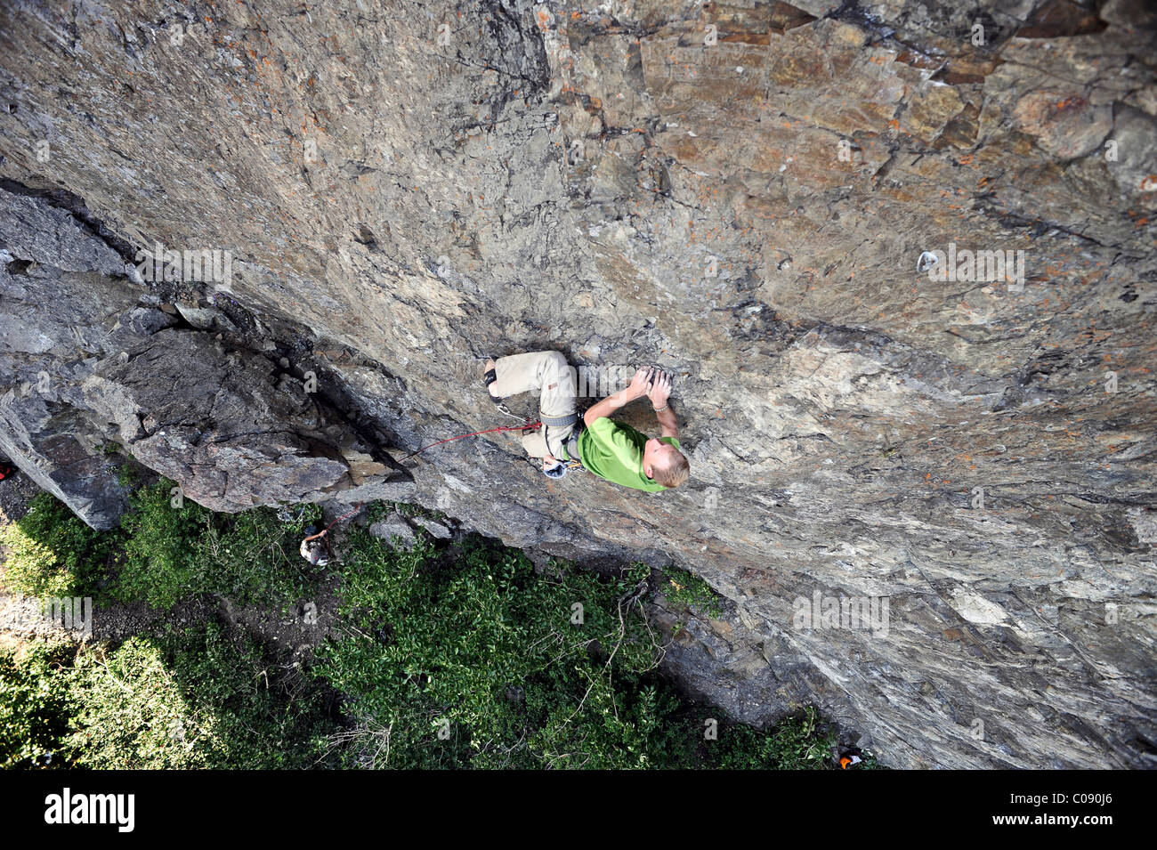 Man rock climbing along Turnagain Arm near Anchorage, Southcentral Alaska, Summer - Stock Image