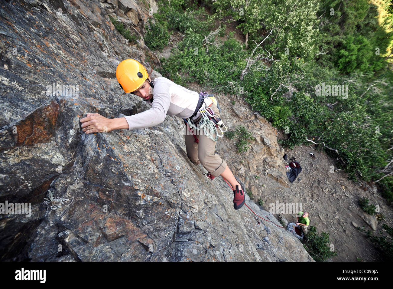 Woman rock climbing along Turnagain Arm near Anchorage, Southcentral Alaska, Summer - Stock Image
