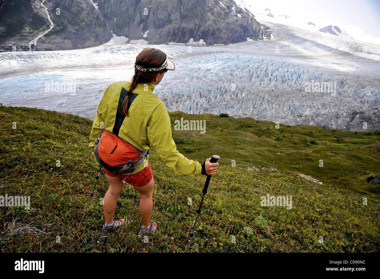 Woman hiking  Exit Glacier in the Harding Icefield, Kenai Fjords National Park, Kenai Peninsula, Southcentral Alaska Stock Photo