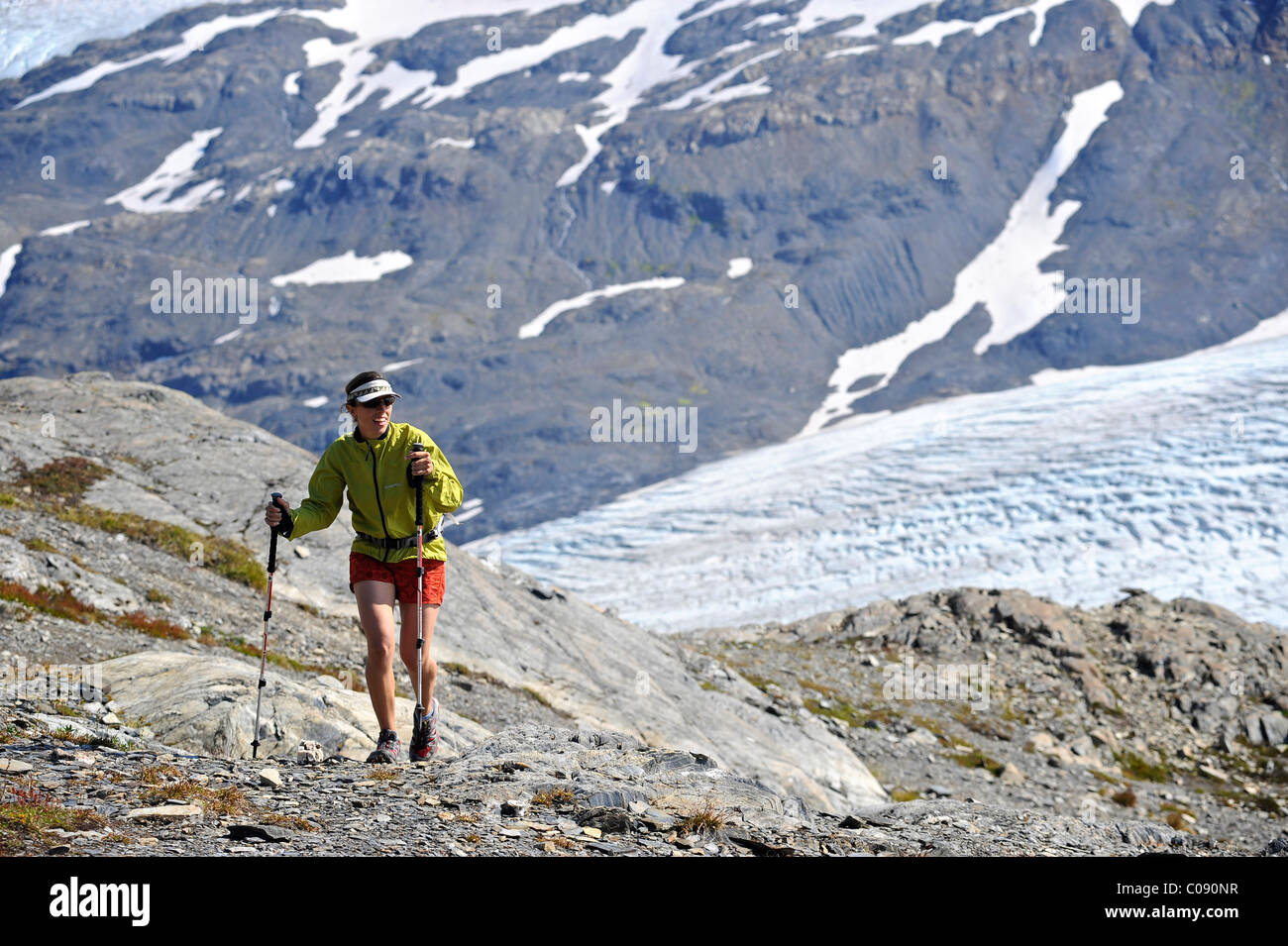 Woman hiking Exit Glacier in the Harding Icefield Kenai Fjords