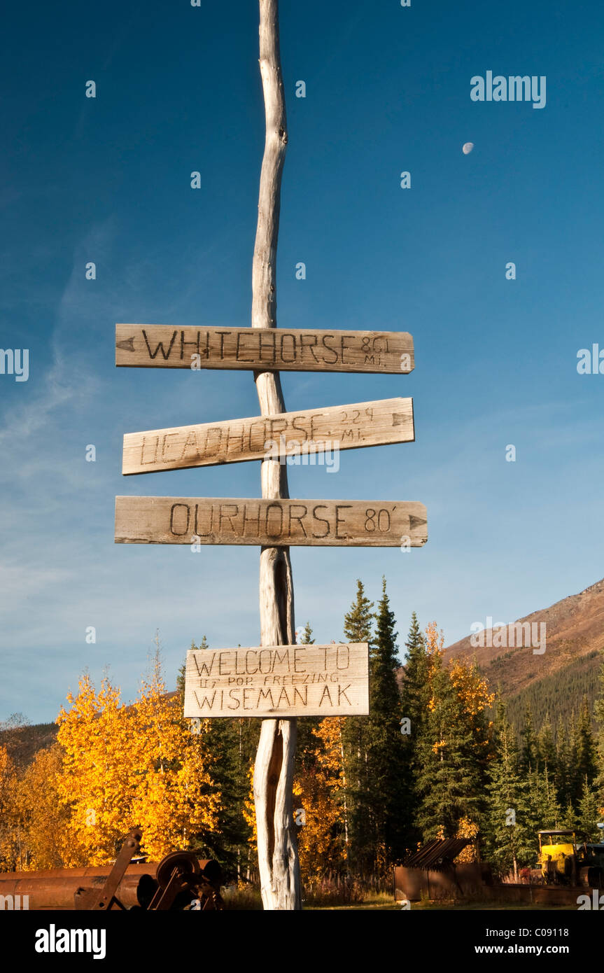 View of a humorous signpost in Wiseman, Arctic Alaska, Fall - Stock Image
