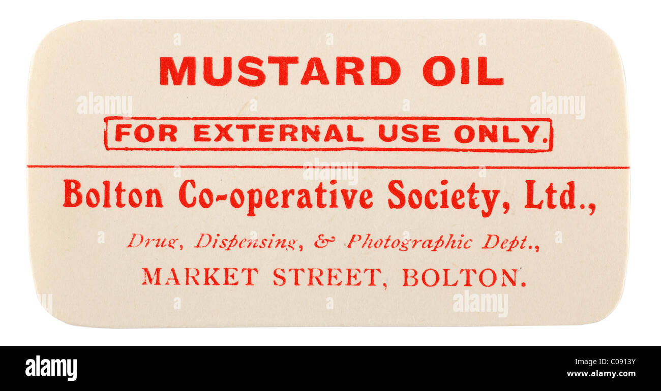 Old vintage chemist label for Mustard Oil from Bolton Co operative Society Ltd. EDITORIAL ONLY - Stock Image