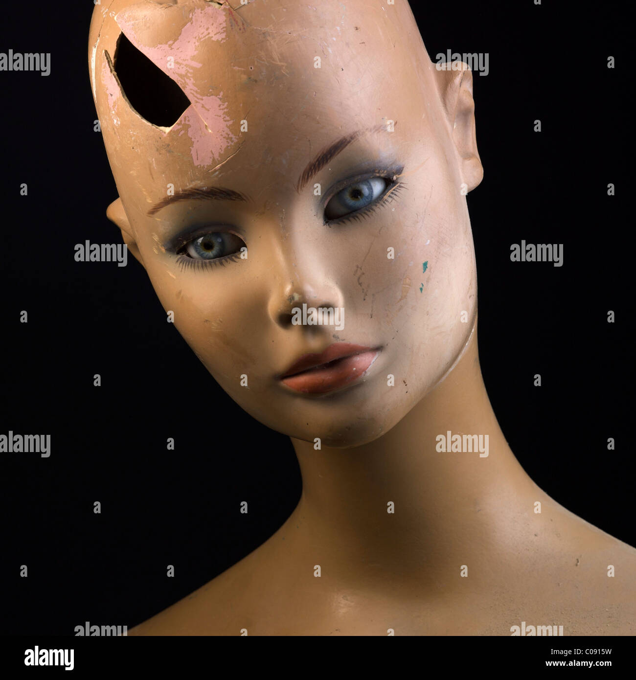 Domestic violence against women concept - close up of the face of broken woman mannequin - Stock Image