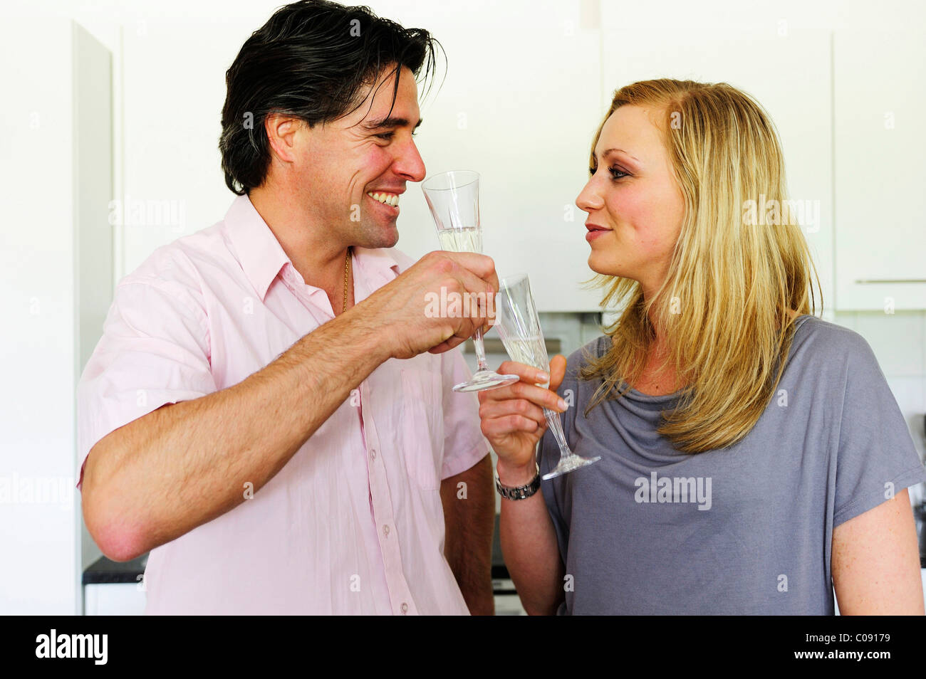 Young couple clinking glasses with champagne Stock Photo