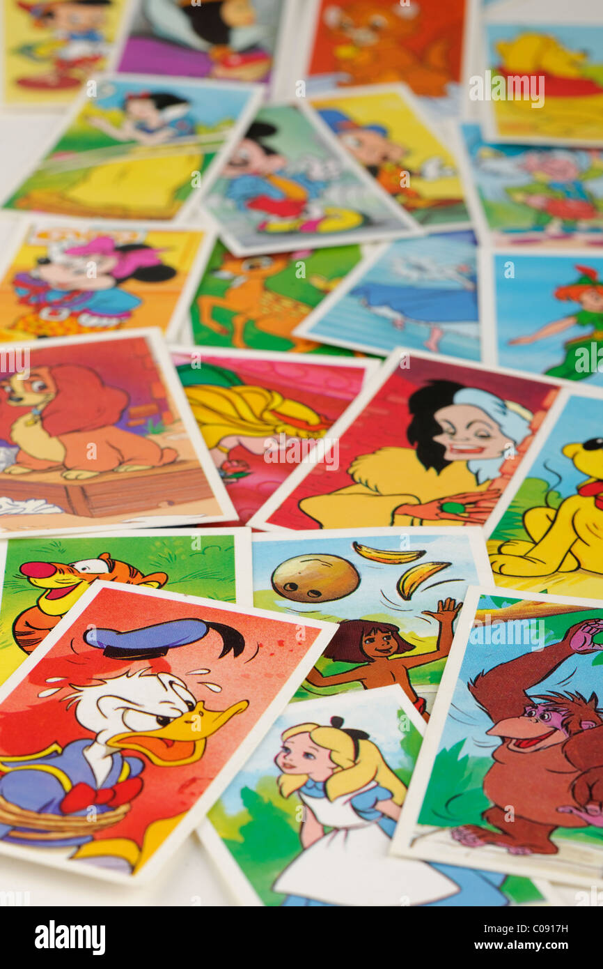 Pile of cigarette cards with Disney characters. EDITORIAL ONLY - Stock Image