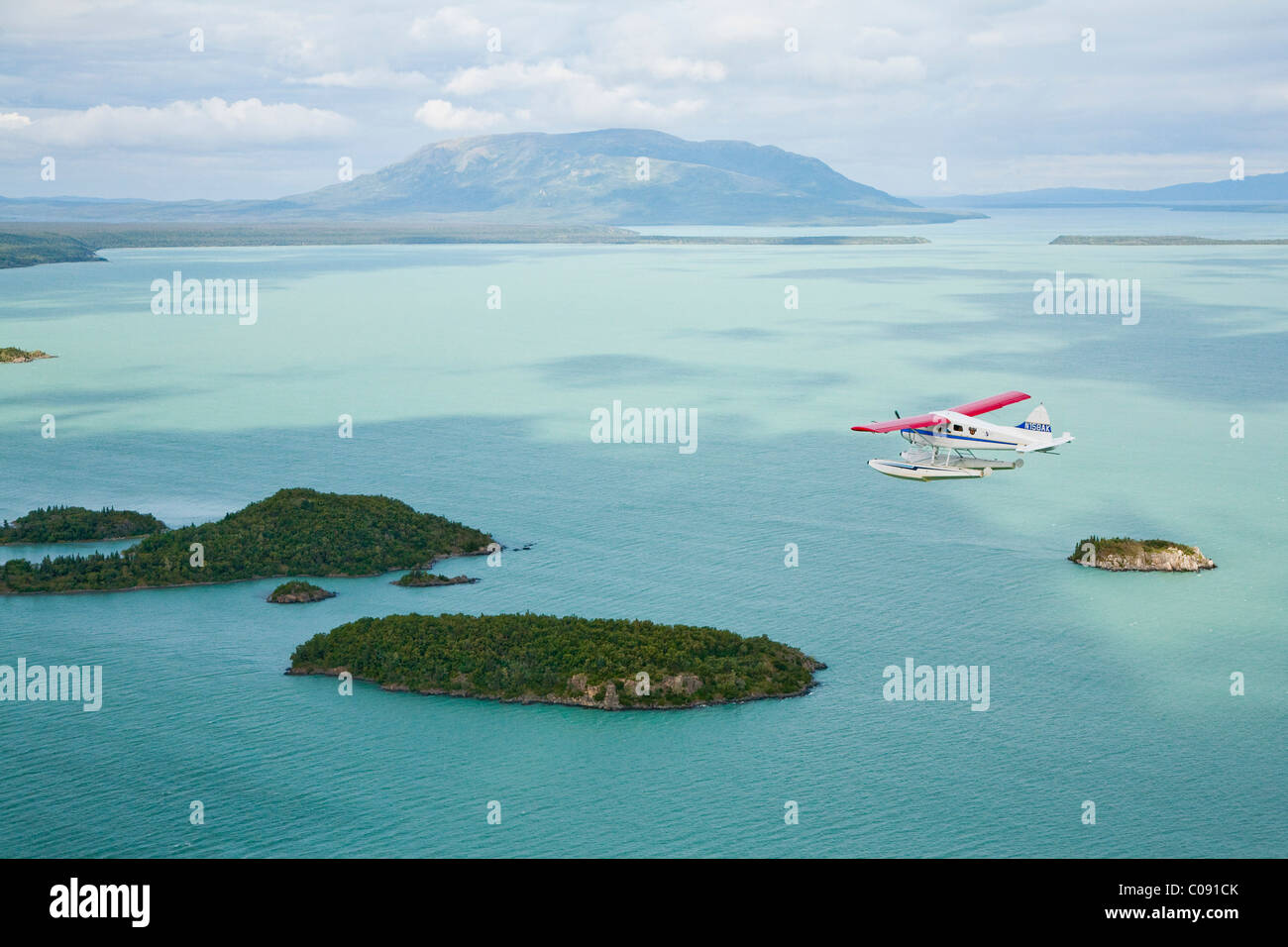 Aerial view of floatplane flying over Bristol Bay near Crystal Creek Lodge, King Salmon, Southwest Alaska, Summer - Stock Image