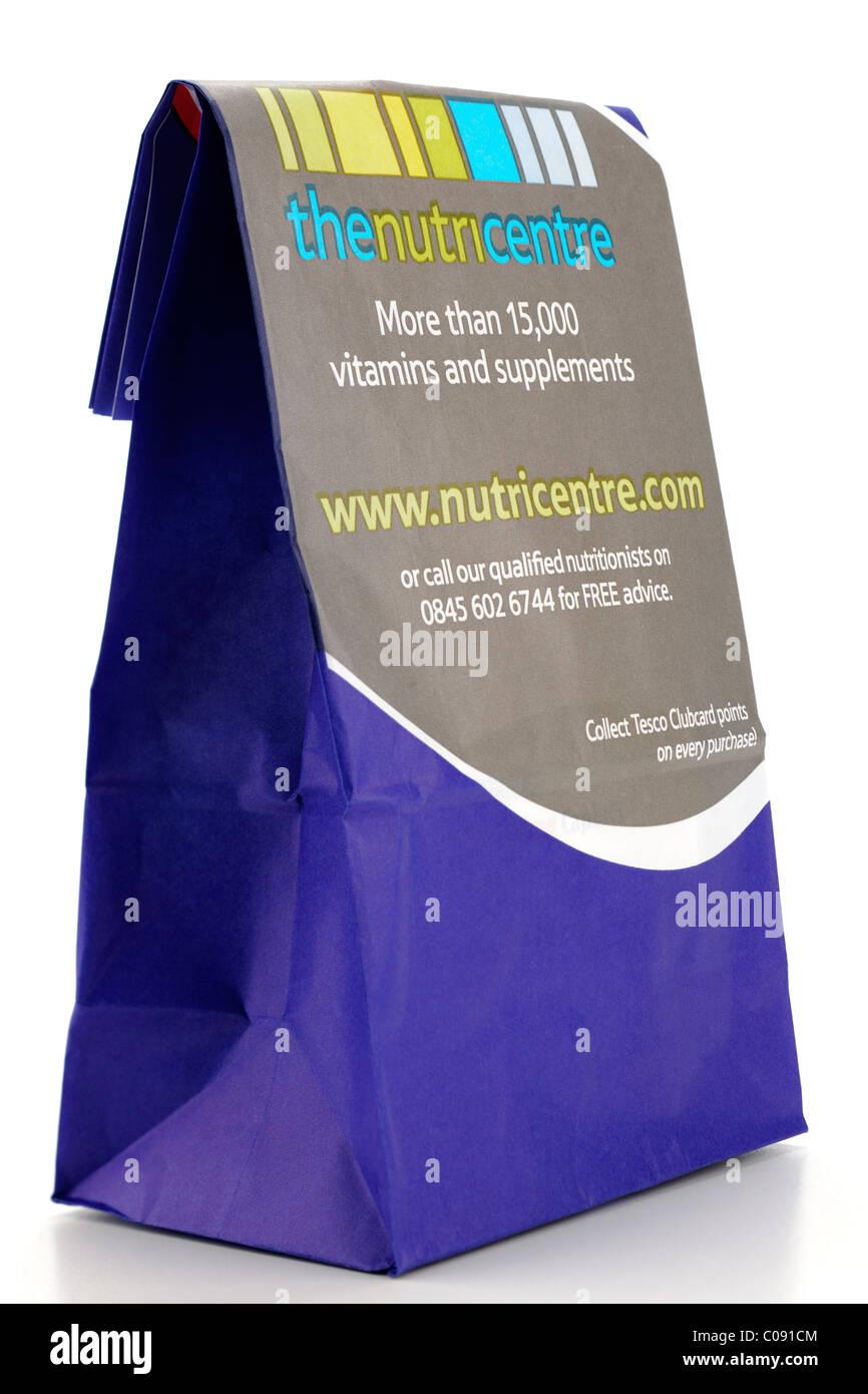 Blue Tesco pharmacy bag advertising www.nutricentre.com. - Stock Image