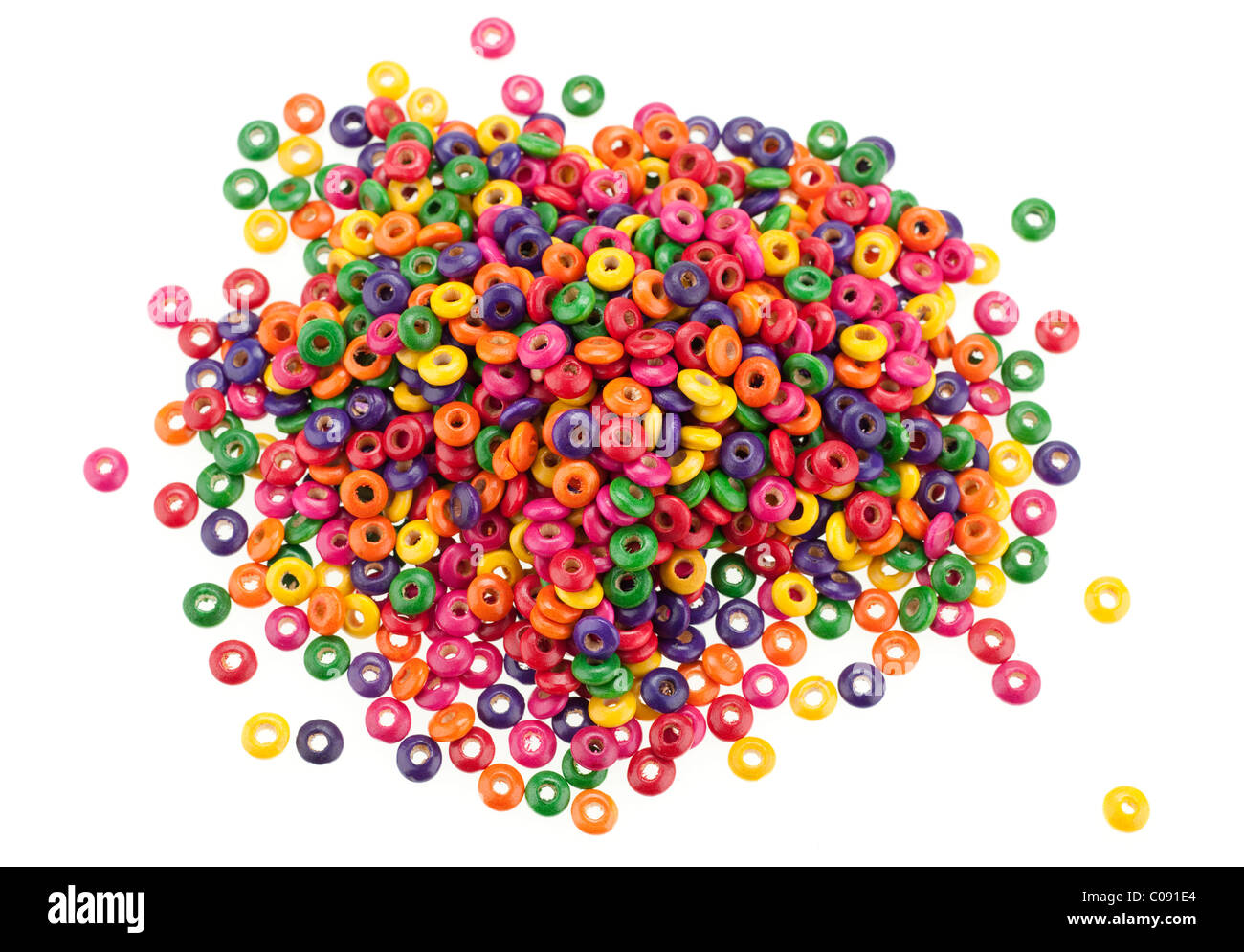 Pile of multicoloured wooden beads - Stock Image
