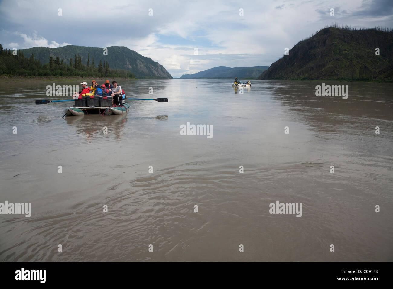 Two rafts of families float down the Yukon River, Yukon-Charley Rivers National Preserve, Interior Alaska, Summer - Stock Image