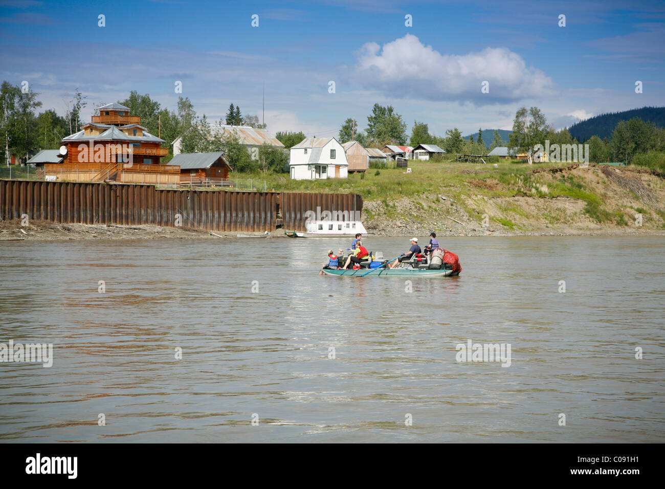 A family floats in a cataraft past the village of Eagle on the Yukon River, Interior Alaska, Summer - Stock Image