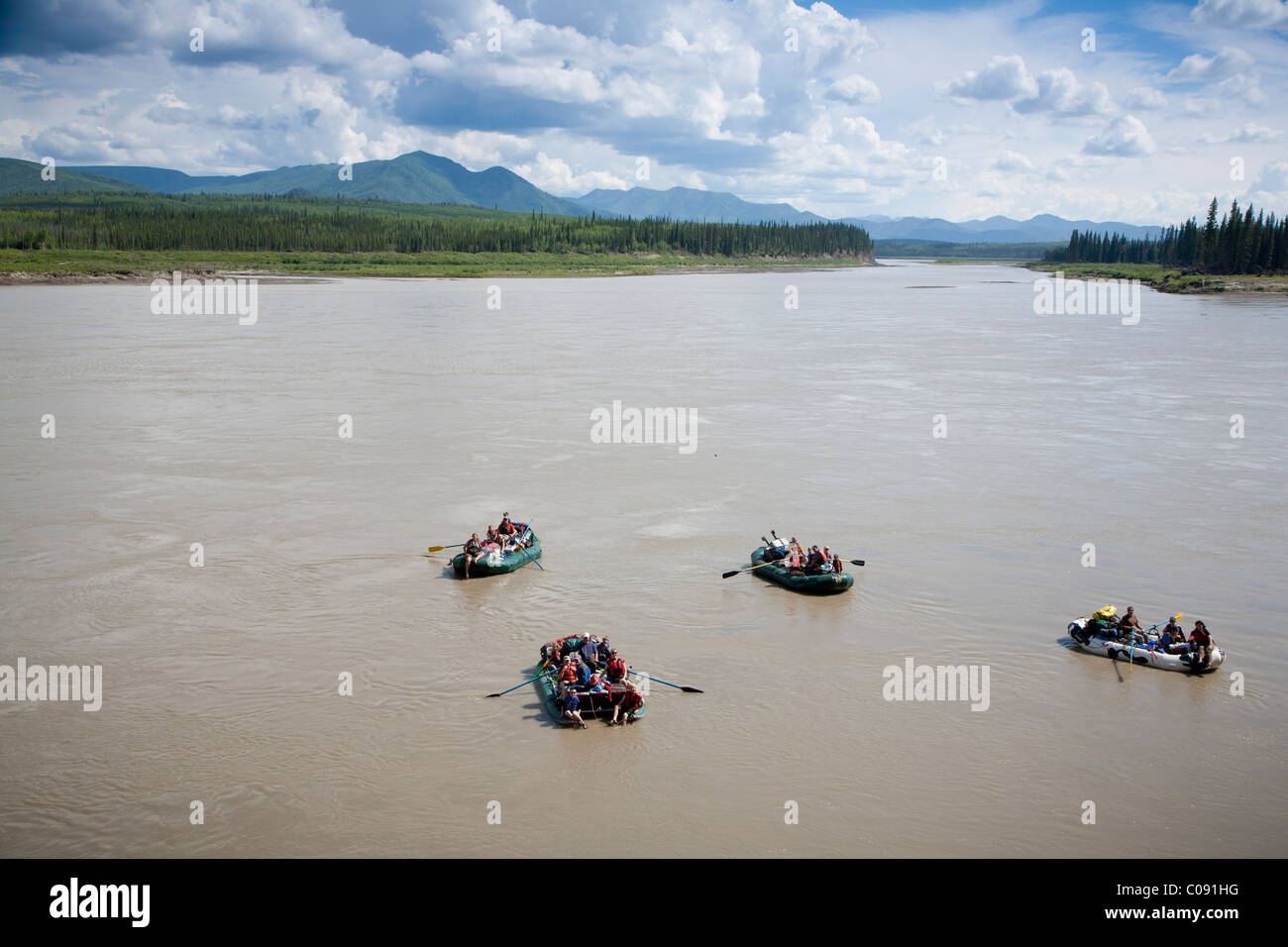 A group of rafters float on the Yukon River near Calico Bluffs in Yukon-Charley Rivers National Preserve,  Interior - Stock Image
