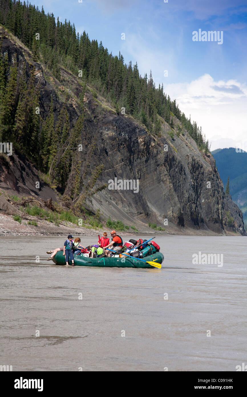 A family floats on the Yukon River in Yukon-Charley Rivers National Preserve,  Interior Alaska, Summer - Stock Image