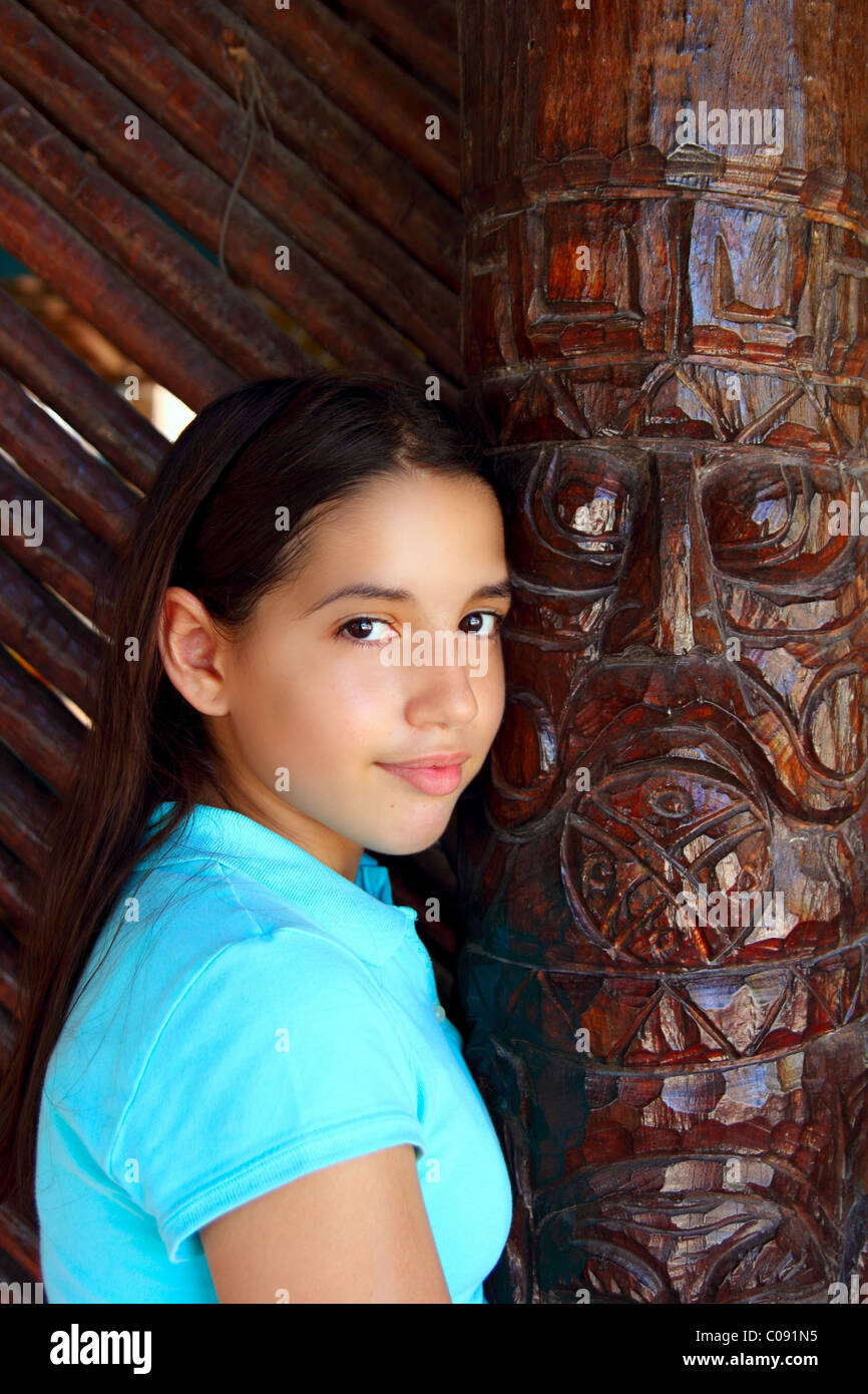 Latin Mexican Teen Girl Smile With Indian Wood Totem Stock Image