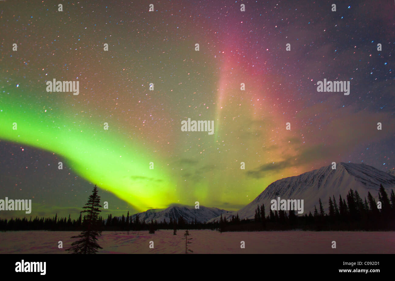 View of Northern Lights over the foothills of the Alaska Range, Broad Pass, Southcentral Alaska, Winter - Stock Image