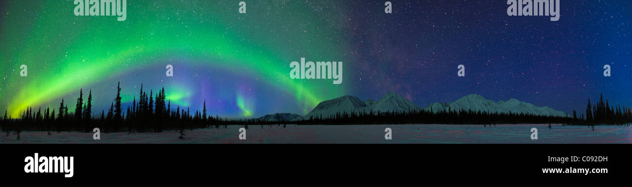 View of Northern Lights over the foothills of the Alaska Range in Broad Pass, Southcentral Alaska, Winter - Stock Image