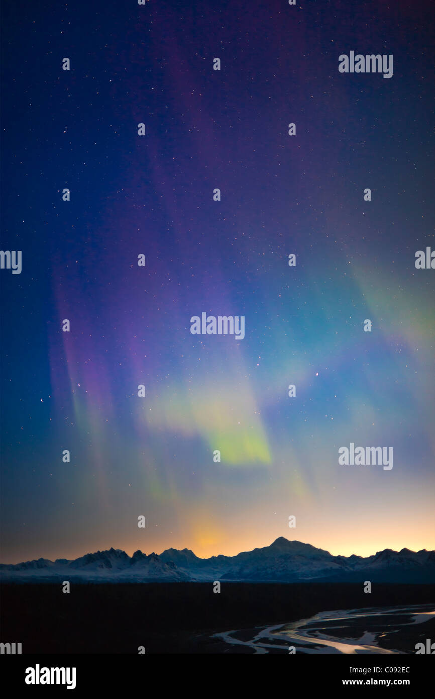 View of Northern Lights in the sky above southside Mount McKinley and the Alaska Range at twilight, Denali State - Stock Image