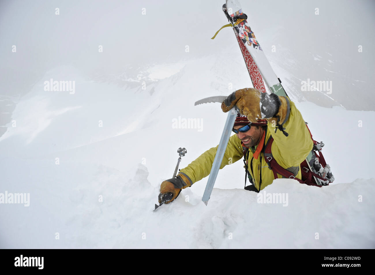 Backpacker approaches the summit of Mt. Chamberlin in the Brooks Range, ANWR, Arctic Alaska, Summer - Stock Image