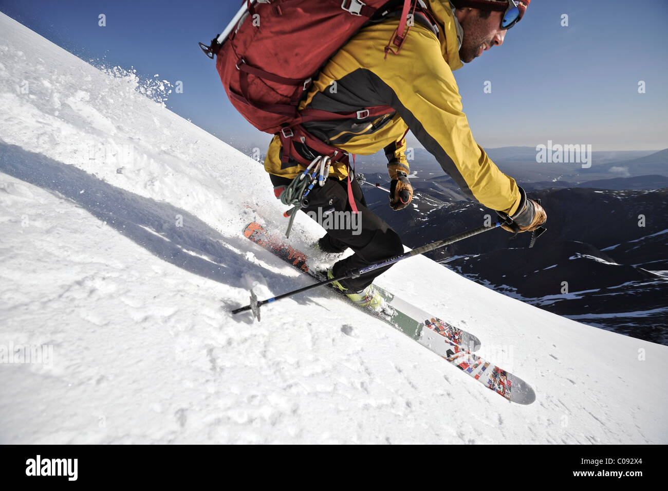 Backcountry skier makes an early morning descent of the north side of Mt. Chamberlin, Brooks Range, ANWR, Arctic Stock Photo