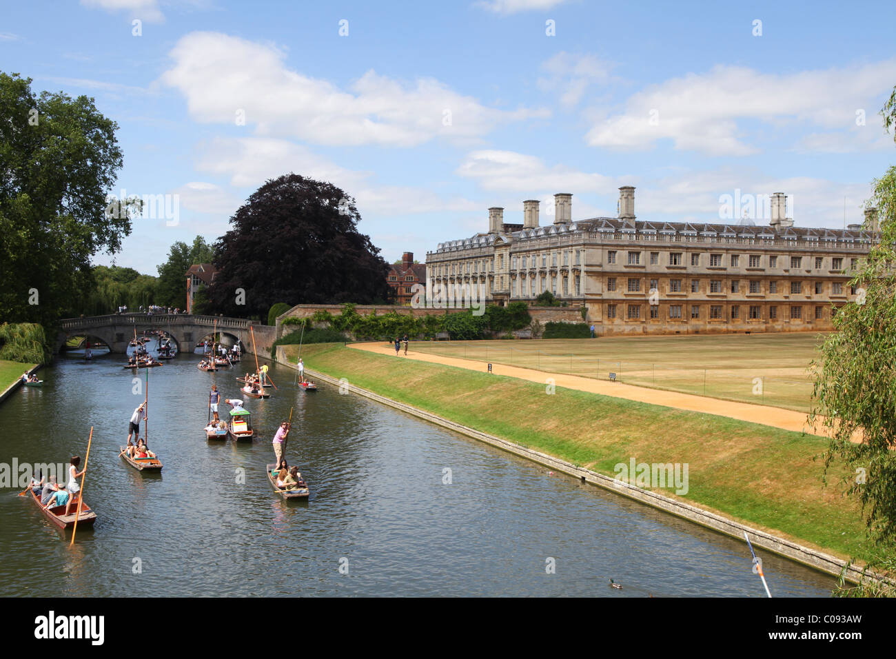 Punters on the Cam river in Cambridge passing Trinity Hall - Stock Image