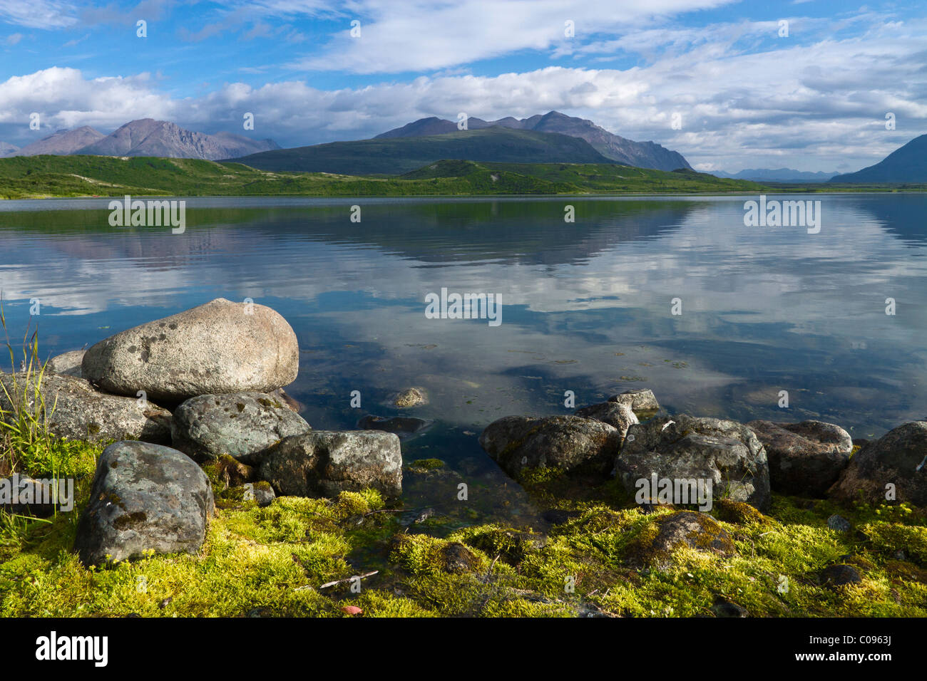 View of Tangle Lake near Paxson with rocks and green moss in the foreground, Interior Alaska, Summer - Stock Image