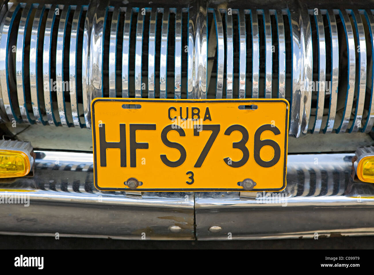 Close up of a number registration plate in Havana Cuba on a 1950's automobile showing chrome grill - Stock Image