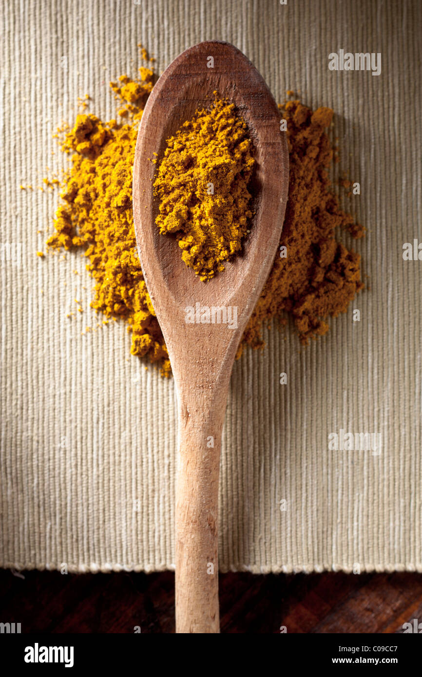 Curry on a Spoon - Stock Image