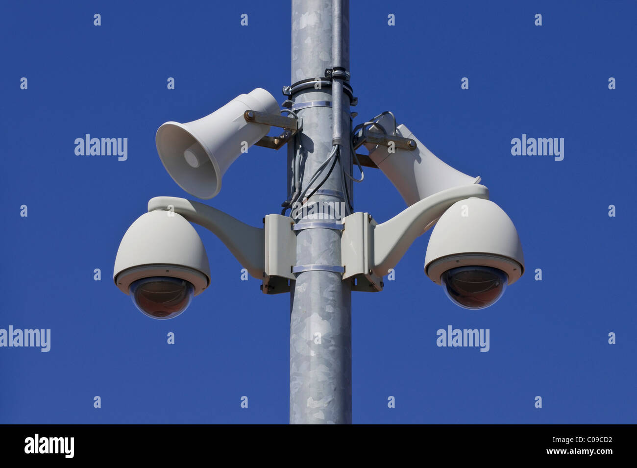Two 360 degree cameras with two megaphones on a pole, surveillance with option for announcements - Stock Image