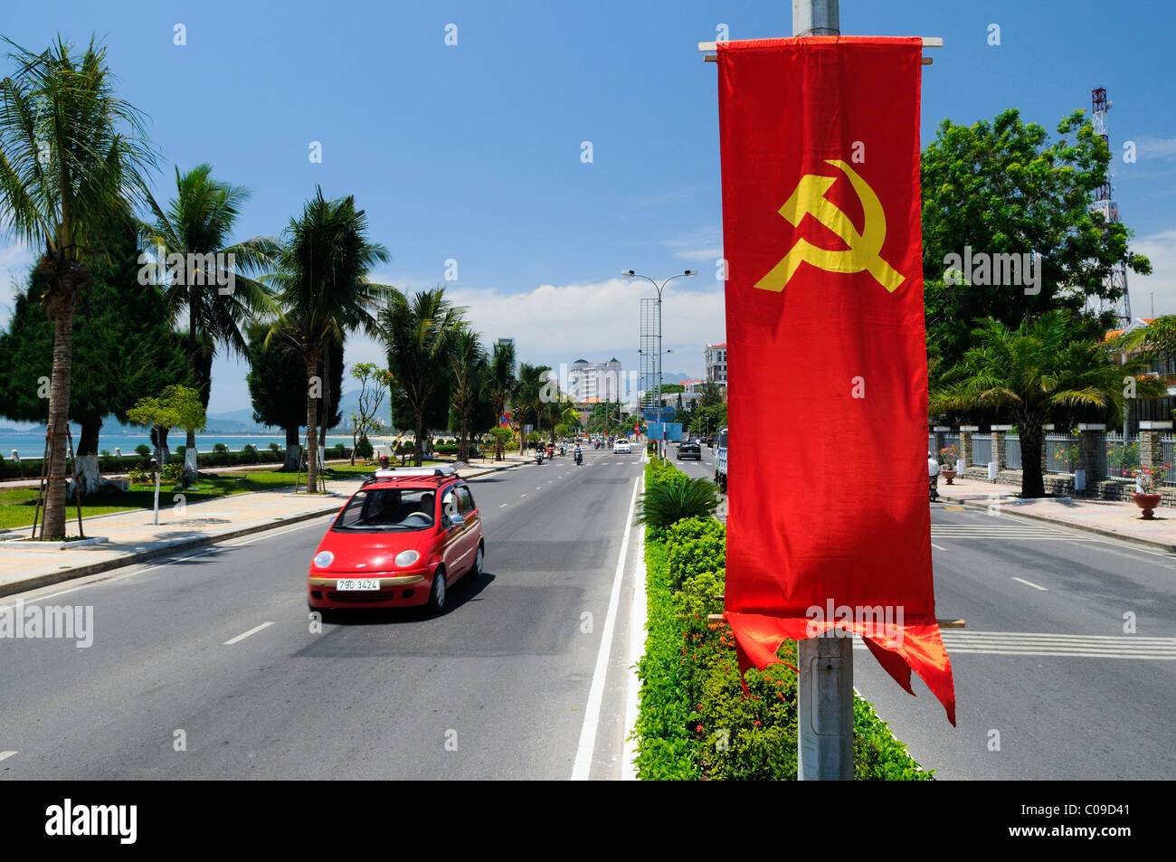 Main street of Nha Trang with communist flag, Vietnam, Southeast Asia - Stock Image
