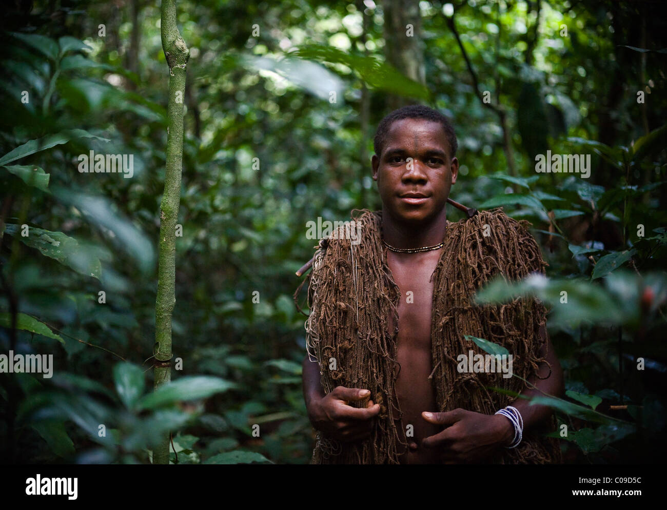 The hunter-pygmy with a net. The hunter-pygmy with a net before hunting - Stock Image