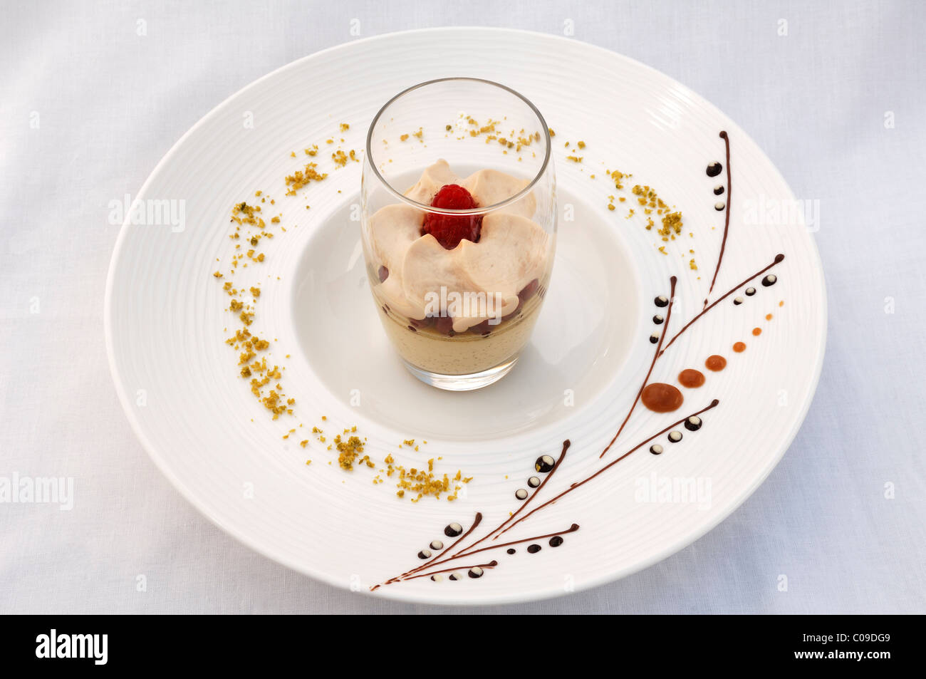 Dessert, latte macchiato mousse on a decorated plate, haute cuisine, Auberge de la Ferme Hueb, Mike Germershausen, - Stock Image
