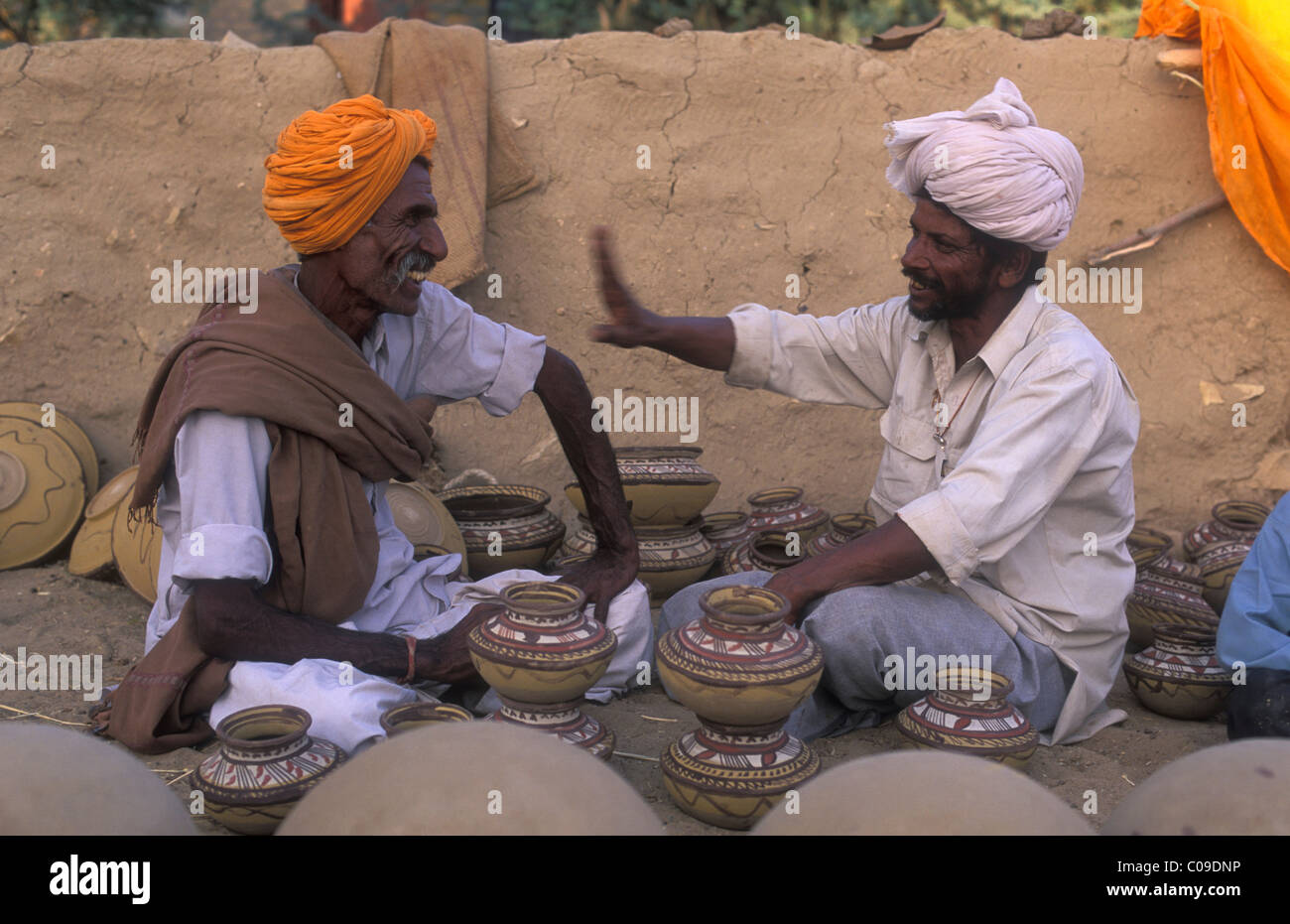 Potters in conversation, Thar Desert, Rajasthan, India, Asia - Stock Image