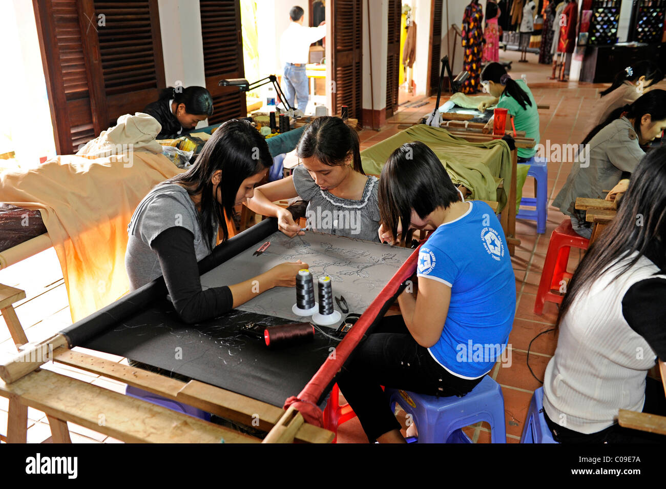 Embroiderers in a textile factory, Hoi An, Quang Nam, Central Vietnam, Vietnam, Southeast Asia, Asia - Stock Image