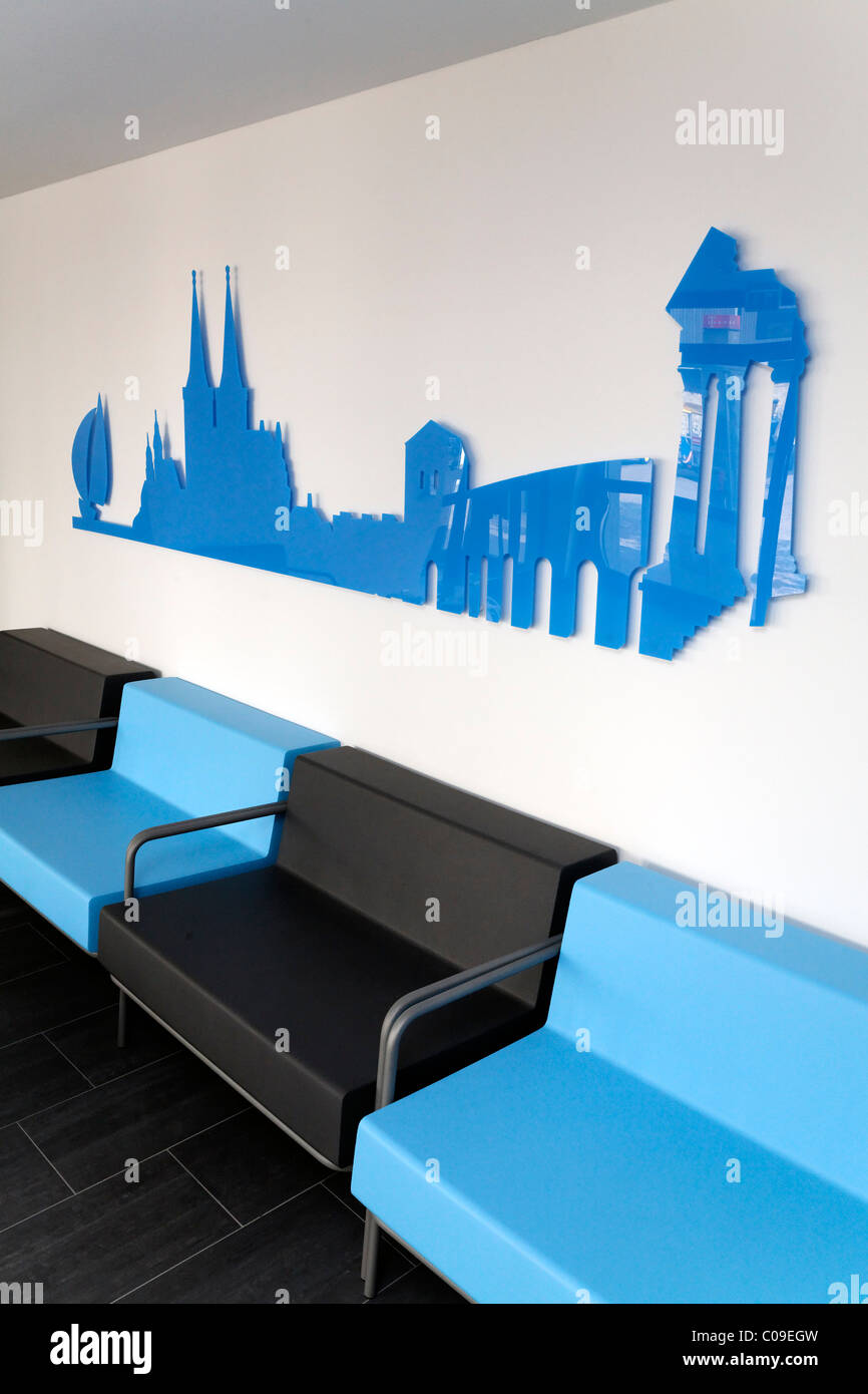 Modern sofa set in front of a silhouette panorama of the sights of Xanten, info lounge Ruhr 2010, Lower Rhine region - Stock Image