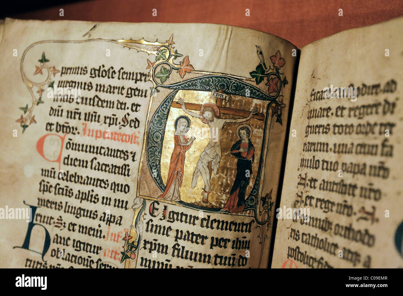 Handwritten missal with artistic illuminations, initial with crucifixion, illumination, Stiftsmuseum Museum Xanten - Stock Image