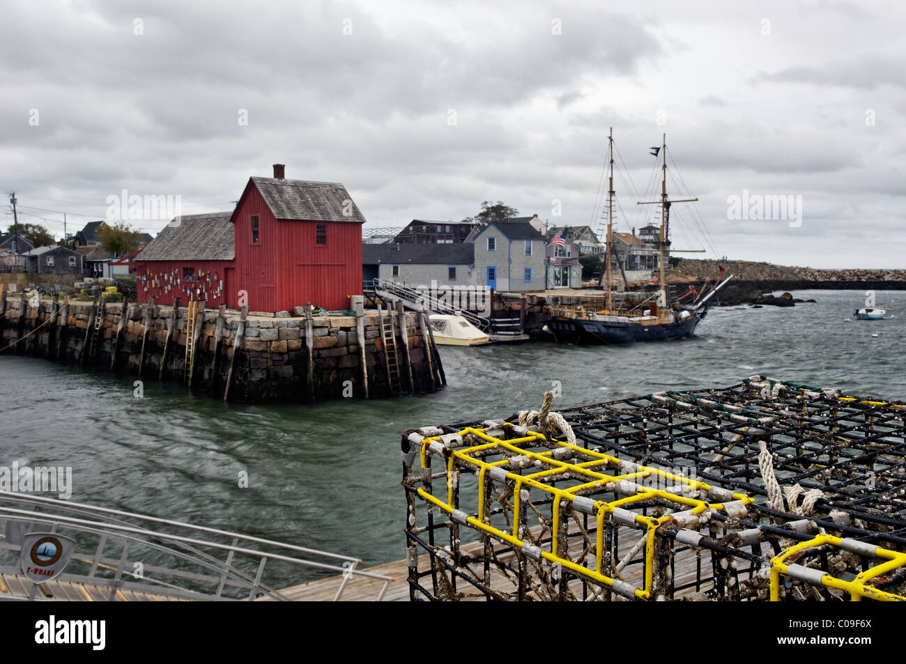 Lobster Traps, Motif Number 1 and Schooner at the Dock in Rockport, Massachusetts - Stock Image