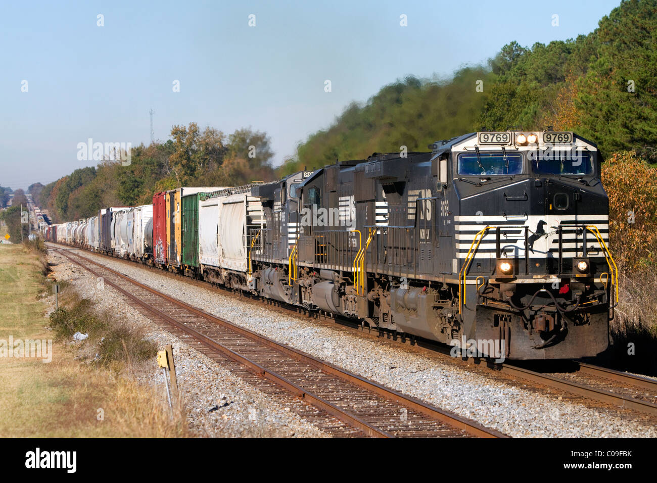 Norfolk Southern Railway locomotive traveling along Highway 72 west of Mussel Shoals, Alabama, USA. - Stock Image