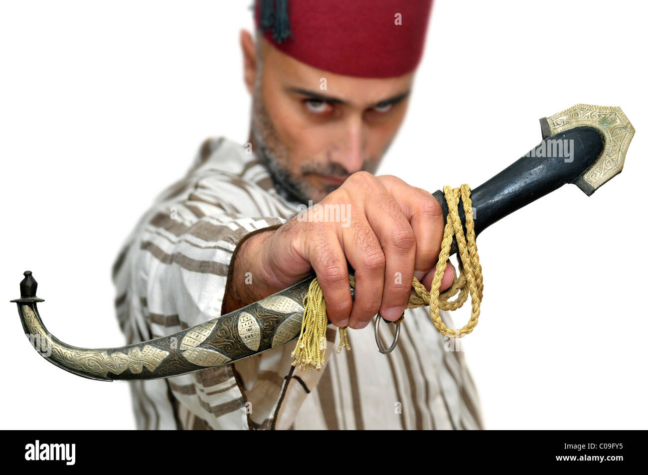 Arabic man with a dagger isolated in white - Stock Image